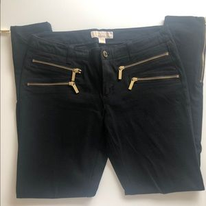 Michael Kors black jeans with gold zippers